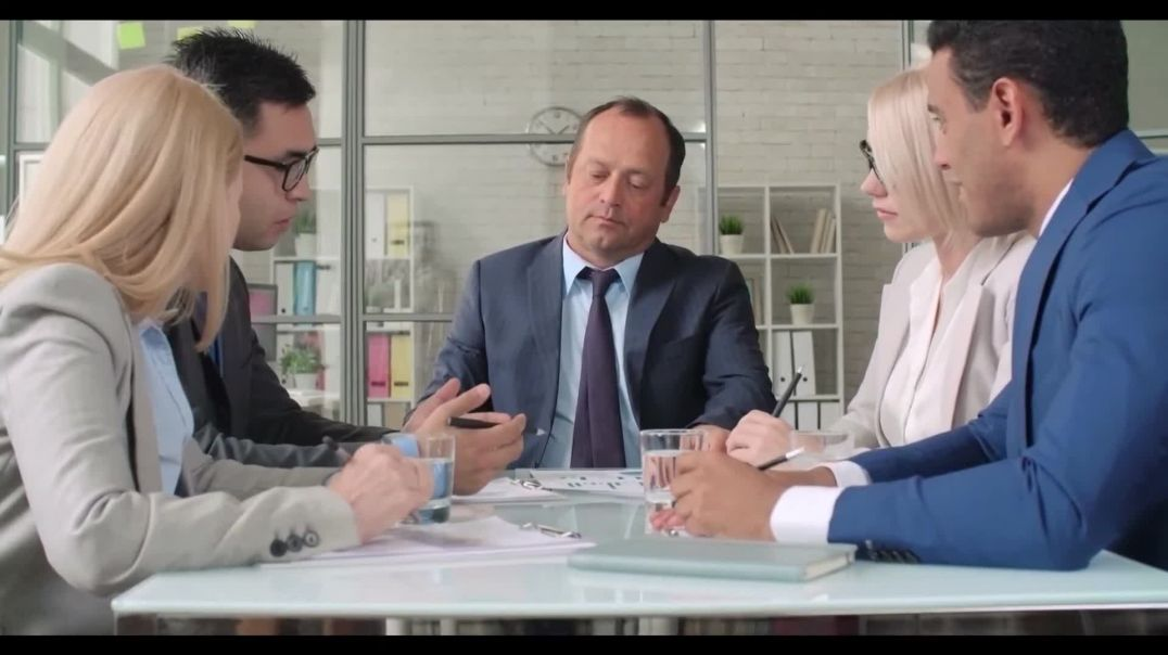 Stock business video of professionals in suits meeting at table discussing proposal